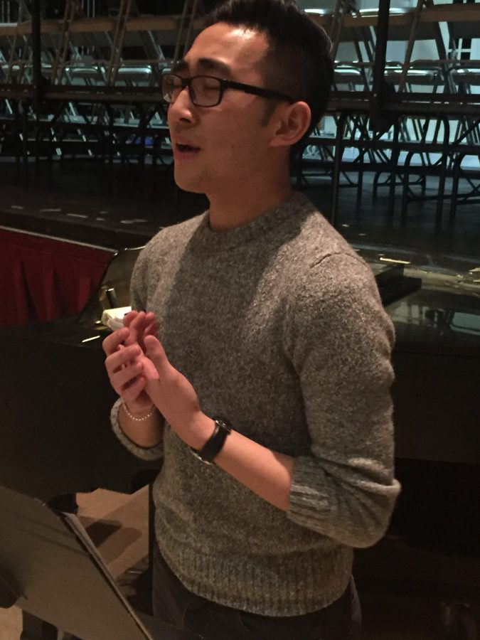"""Forte in a foreign language—Senior Giovanni Xu passionately practices the song """"Sur la Place"""" from Act I, Scene I of Carmen.    Photo by Annie Zhang"""