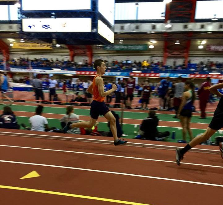 Running+Towards+College%E2%80%94Senior+John+Gould+competes+in+the+1600+meter+during+the+winter+track+season.+He+will+be+running+cross+country+for+SUNY+Purchase+next+year.+Photo+reproduced+by+permission+of+John+Gould